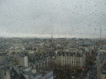 Our first view of the Eiffel Tower through a rain spattered window at the Pompidou Centre