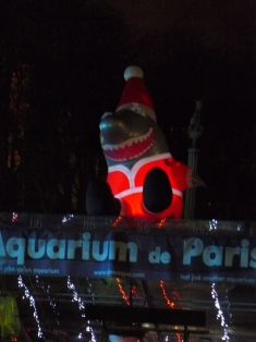 Traditional Paris view - a shark in a Santa suit