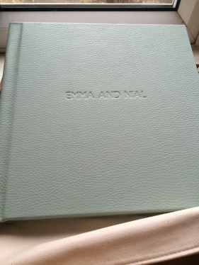 Our names on our pretty album!