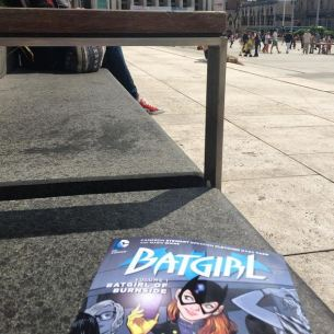 Reading Batgirl in the Market Square